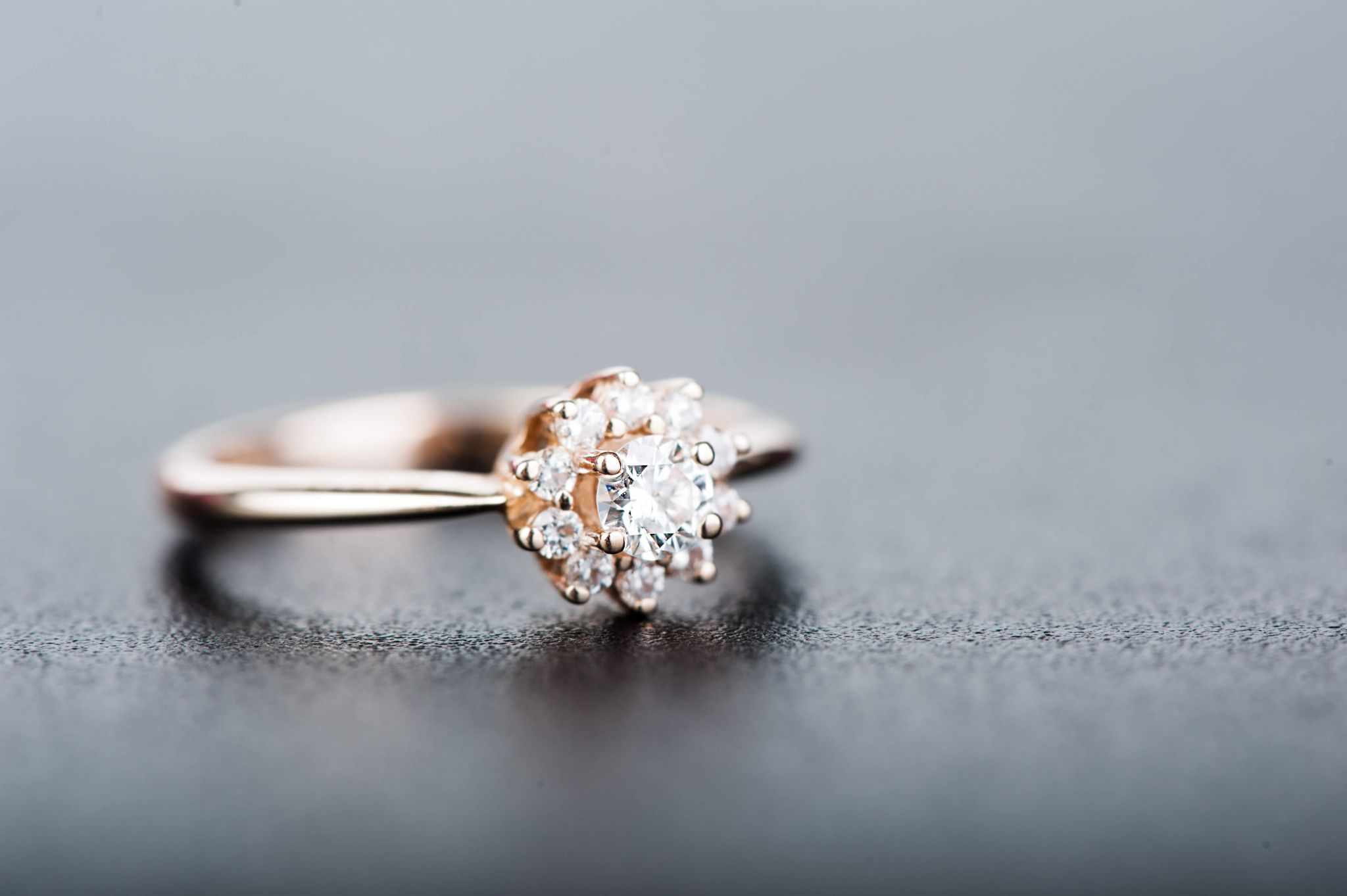 vintage engagement rings - diamond ring on a grey background
